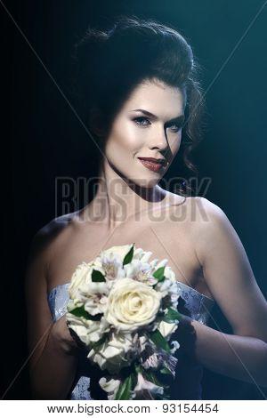Gorgeous Brunette Bride With Wedding Bouquet.