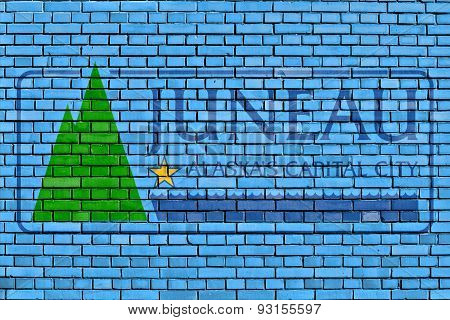 Flag Of Juneau Painted On Brick Wall