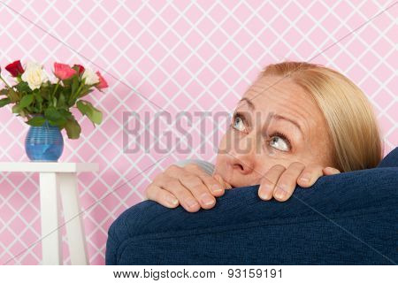 middle aged woman having fear in the living room