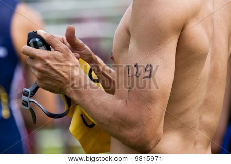 number on the arm of a swimmer