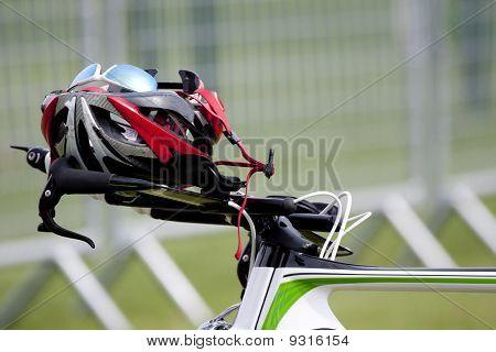 Helmet on the handlebars of a bike triathlon