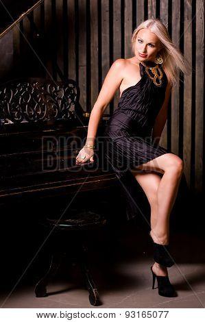 Beautiful girl sitting near piano