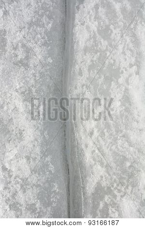 Fissure On The Ice As A Background