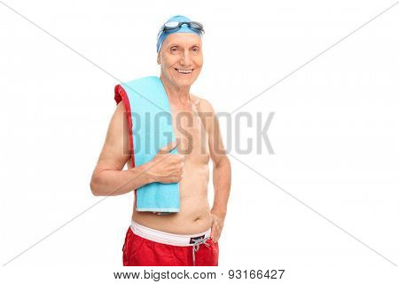 Cheerful senior man with a swimming cap and goggles looking at the camera and smiling isolated on white background