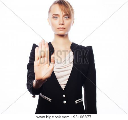 Business, finance and people concept: young business woman making stop desture. Isolated on white background.