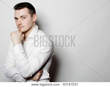 business, successful and people concept - young business man thinking, over white background.