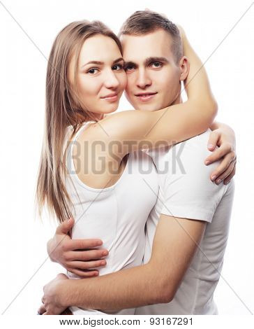 Love, family and people concept: lovely happy couple hugging over white background.