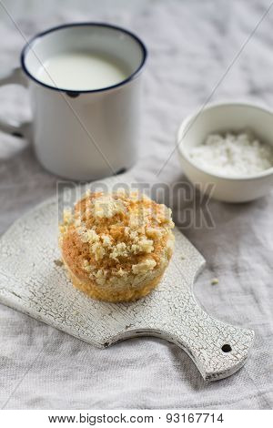 Muffin And Mug Of Milk On A Light Surface In A Vintage Style