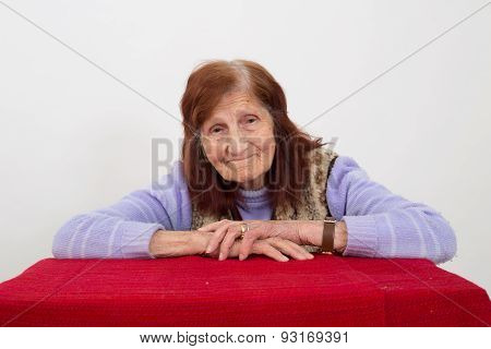 Portrait of an elderly woman with satisfied face expression