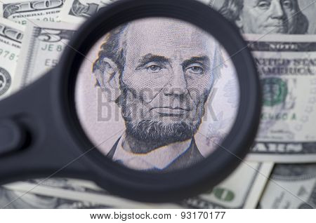 Lincoln On Five Dollar Over Heap Of Dollars United States As A Background