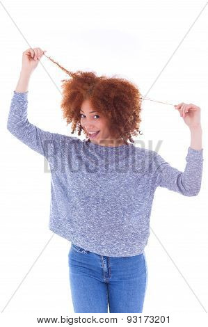 Young African American  Teenage Girl Holding Her Curly Hair Isolated On White Background