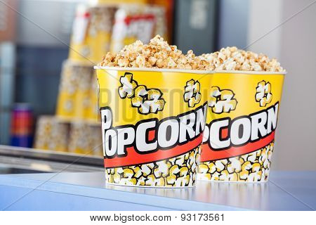 Buckets full of popcorn at concession stand in cinema