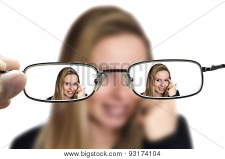blonde woman through glasses