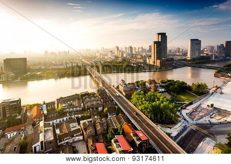 High angle view of modern skyline and cityscape at sunset near river