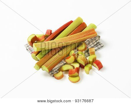 fresh rhubarb stems on checkered dishtowel