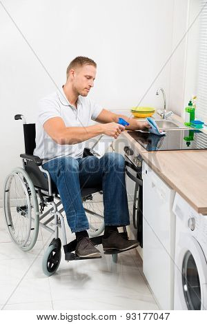 Handicapped Man Cleaning Induction Stove