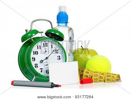 Alarm clock with bottle of water and empty blank paper card sign, isolated on white background