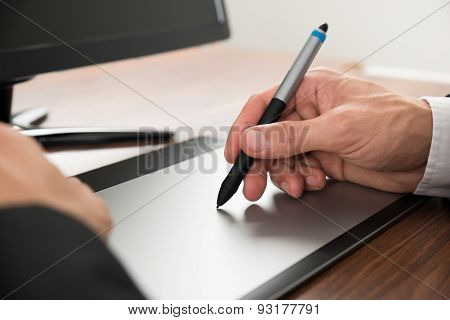 Businessman Drawing On Graphic Tablet