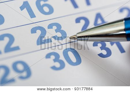Close-up Of Calendar And Pen