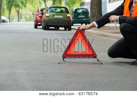 Red Warning Triangle With A Broken Down Cars