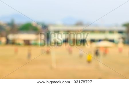 Blurred Shot Of Soccer Field At School On Day Time Image For Background Usage .