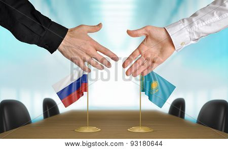 Russia and Kazakhstan diplomats agreeing on a deal
