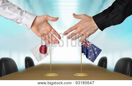 Japan and Australia diplomats agreeing on a deal