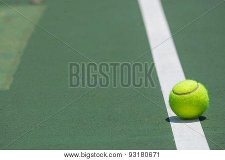 Tennis Ball on the green Court .sport concept