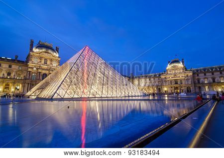 Paris, France - May 14, 2015: Tourist Visit Louvre Museum At Twilight In Paris.
