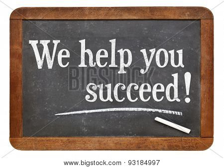 We help you succeed - marketing text on a vintage slate blackboard