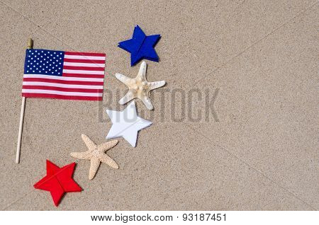 Amrican Flag With Starfishes On The Sandy Beach