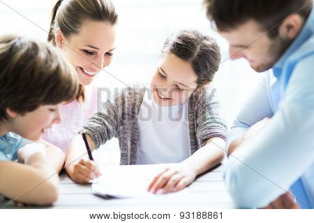 Family doing homework together at table