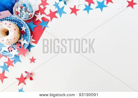 american independence day, celebration, patriotism and holidays concept - close up of glazed sweet donut with candies in disposable tableware and stars at 4th july party from top
