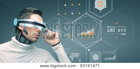 people, technology, future and progress - man with futuristic 3d glasses and microchip implant or sensors over gray background with virtual charts