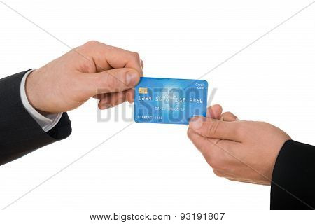 Two Businessman Holding Credit Card