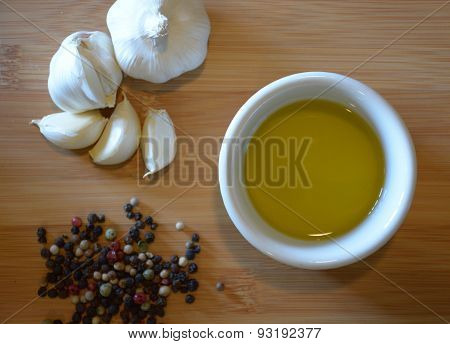 oil, garlic, and pepper