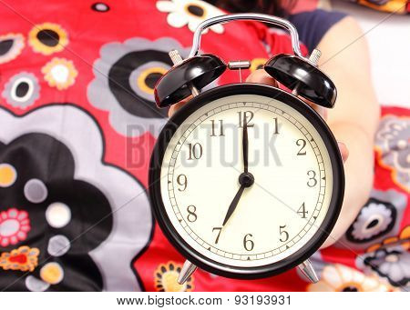 Seven O'clock Indicated On The Alarm Clock