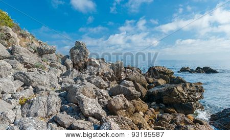 Rocky sea shore at fall season