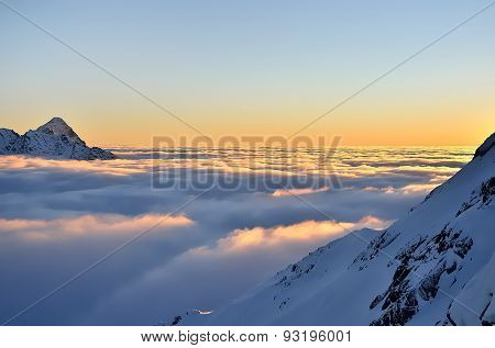 Winter mountain landscape with sea of clouds.