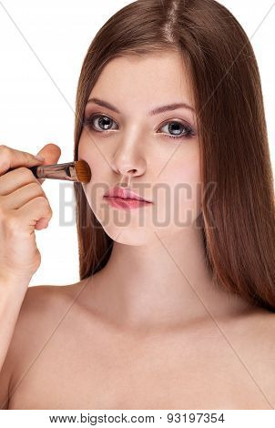 Beautiful Girl With Make Up Brush On White Background