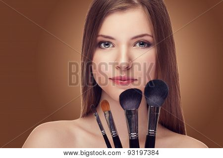 Smiling Girl With Make Up Brushes In Hands