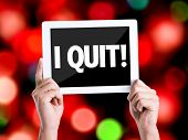picture of quit  - Tablet pc with text I Quit with bokeh background - JPG