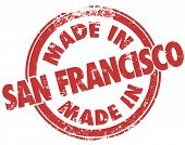 picture of manufacturing  - Made in San Francisco words in a red grunge style stamp to illustrate or advertise products manufactured or produced in SF in the state of California - JPG