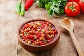 image of chickpea  - cooked chickpeas with tomatoes in a bowl - JPG