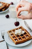 stock photo of whip-hand  - Breakfast with wholegrain brussels waffles and whipped cream - JPG