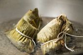 stock photo of chinese wok  - Zongzi boiling in a wok - JPG