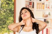 foto of early morning  - Female model in tank top early morning neck stretching - JPG