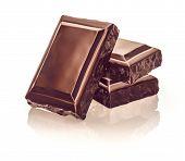 stock photo of bittersweet  - Chocolate blocks stack on white background - JPG