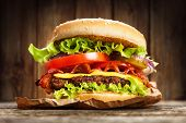 foto of hamburger-steak  - Delicious hamburger on wooden background - JPG