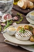 foto of baguette  - Grilled camembert with Dijon mustard and herbs baguettes - JPG